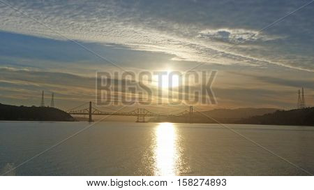 A sunbeam in the morning in the bay of San Francisco, in the background a part of the San Francisco-Oakland Bay bridge