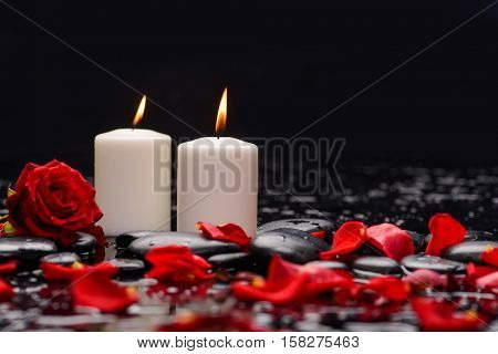 Still life with red rose ,petals with two candle and therapy stones