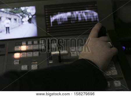 Tv Editor Working With Audio Video Mixer In A Television Broadcast
