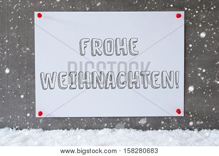 Label With German Text Frohe Weihnachten Means Merry Christmas. Urban And Modern Cement Wall As Background On Snow With Snowflakes.