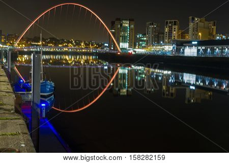 Boat And Bridges Night-time Photograph Of Newcastle And Gateshead Quayside, England