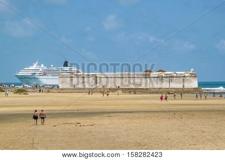 Ancient fort and Big cruise reaching the coast of beach in Natal Brazil