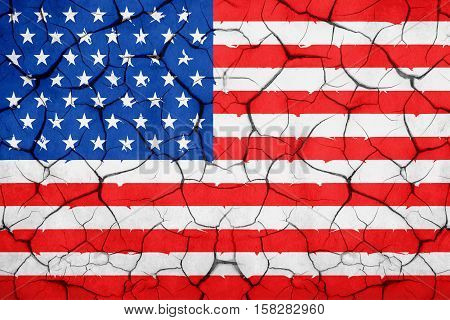 closeup of grunge American USA flag broken crack wall with rift united states of america vote for president concept