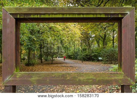 View Through Lhollow Picture Frame Of Trees And Walking People