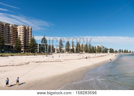 Adelaide Australia - August 28 2016: Children and families enjoying a day at the beach at Glenelg South Australia.