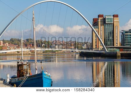 Newcastle Gateshead Quayside with River Tyne Gateshead Millenium Bridge and a Boat in view