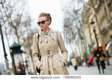 Beautiful Yuong Woman On Champs-elysees In Paris