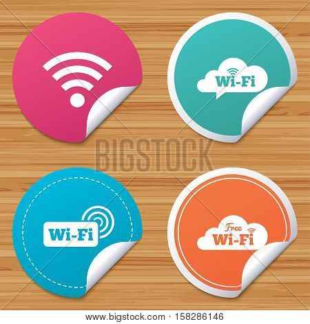 Round stickers or website banners. Free Wifi Wireless Network cloud speech bubble icons. Wi-fi zone sign symbols. Circle badges with bended corner. Vector