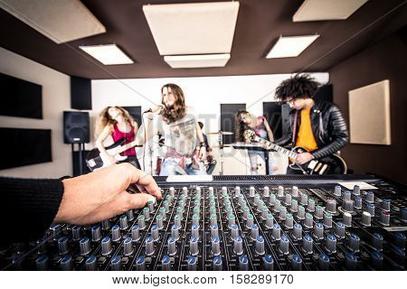 Rock band in action recording new songs