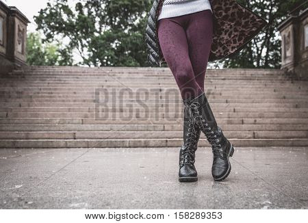 Woman legs during a rainy autumn day
