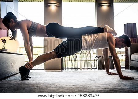 Couple making tag fitness in the living room at home
