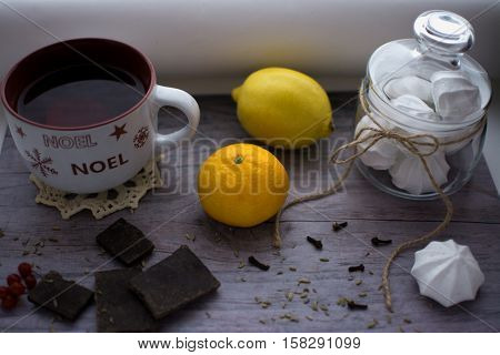 cup of tea lemon mandarin and meringue on the table