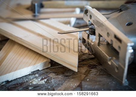 Fretsaw, Hammer, Knife And Tongue And Groove Boards On Working Place