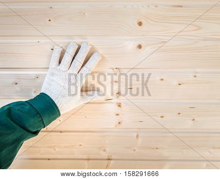 Human Palm In Gloves On Tongue And Groove  Wall