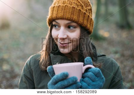 Woman drinking outdoor.