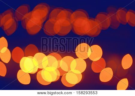 Abstract colorful blurry background cold and warm colors tone cinematic effect evening night street romantic lights