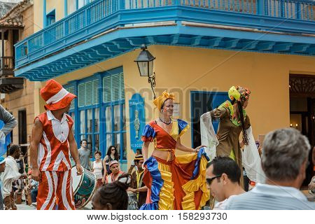 Havana, Cuba, Nov. 26, 2013, beautiful amazing fragment of view of happy joyful entertainment people walking and participating in Cuban carnival on Havana city street