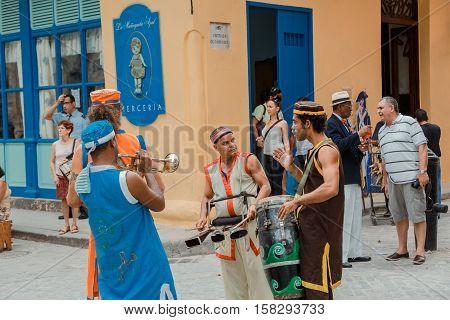 Havana, Cuba, Nov. 26, 2013, Havana, Cuba, Cuban musicians communicating what to play next and get ready for street carnival in Havana city