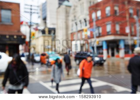 Blurred blurry soft focus background busy downtown street with cars and lights urban city life concept old historical and modern buildings