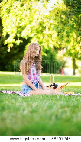 Girl Having A Picnic In Park
