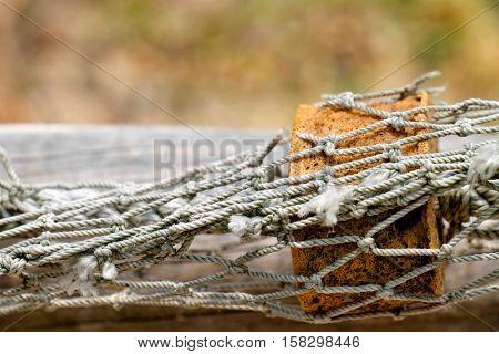 Float in the fishing net.Closeup