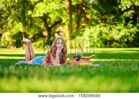 Beautiful Girl Having A Picnic In Park