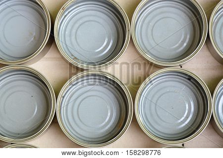 empty tin can food in brown paper box