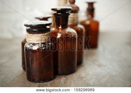 Vintage glass bottles on wooden table, closeup