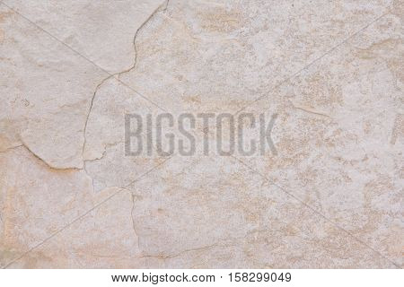 Yellow white creme beige light stone textured background with lines curves waved closeup