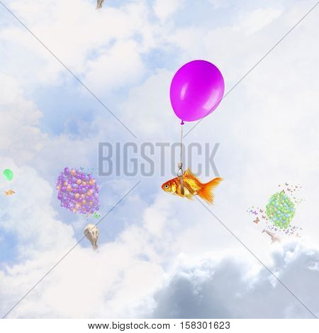 Abstract collage. floating gold fishes under baloons. . Mixed media
