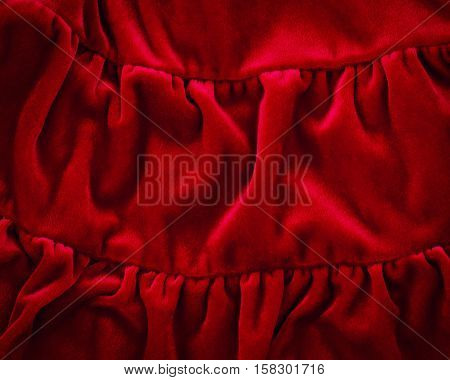 Closeup macro texture of red crimson burgundy fleece fabric clothing background with wrinkles and folds luxury royal concept