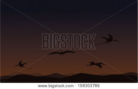 pterodactyl on sky landscape of silhouettes vector illustration