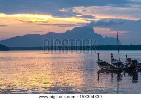 Longtail fishing boat at Samchong-Tai fishing village on sunrise in Phang-Nga Thailand.