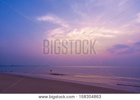 Romantic sunset colourful sweet sky magical cloud and a couple at tropical beach.