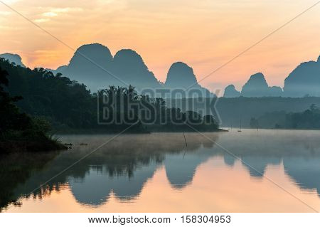 Beautiful sunrise and reflections at natural lagoon Nongtalay lagoon in Krabi Province Thailand.