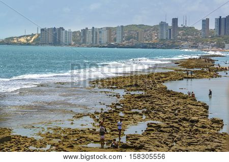 NATAL, BRAZIL, JANAURY - 2016 - Modern waterfront buildings and paradise beach in Natal Brazil