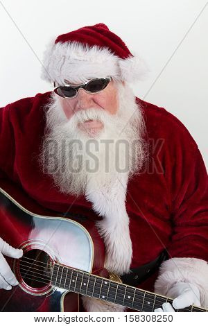 Musician Santa wearing cool shades and playing a red guitar