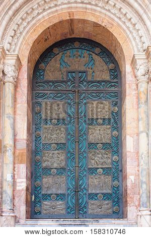 Pink Carrera marble from Italy surrounds the impressive detailed door of the New Cathedral in Cuenca Ecuador