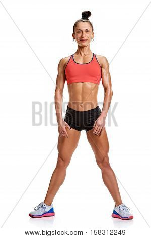 a young and very fit woman in studio on grey background