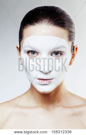 young pretty woman with facial white mask isolated close up spa, lifestyle real people healthcare concept