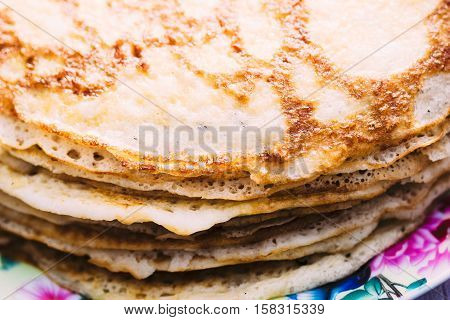 Pancakes close-up folk dish of the eastern Slavs. Maslenitsa