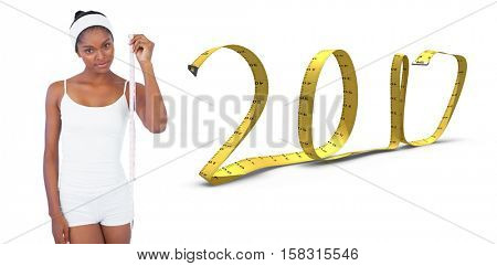 Slender woman holding measuring tape against white background with vignette 3D new year