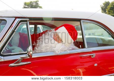 Santa Claus drives his Hot Rod Car. Santa Drives his car. Santa Claus arrives in style. Santa Cruises in his Classic Car. Santa Claus Drives. Santa Claus Car. Santa Car.