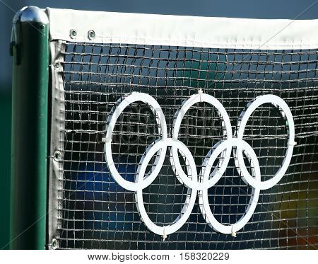 RIO DE JANEIRO, BRAZIL - AUGUST 13, 2016: Olympic rings at the main tennis venue Maria Esther Bueno Court of the Rio 2016 Olympic Games at the Olympic Tennis Centre