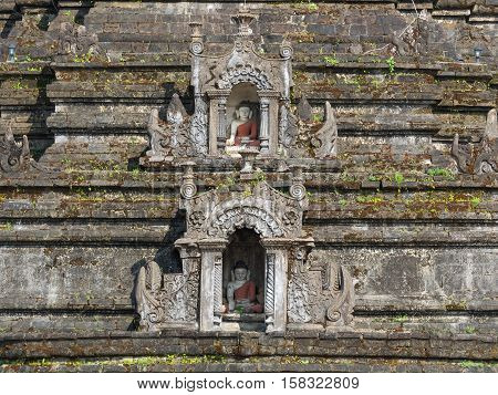Detail of Sakya Man Aung a pagoda in Mrauk U the Rakhine State of Myanmar with two small Buddha images in wall niches.