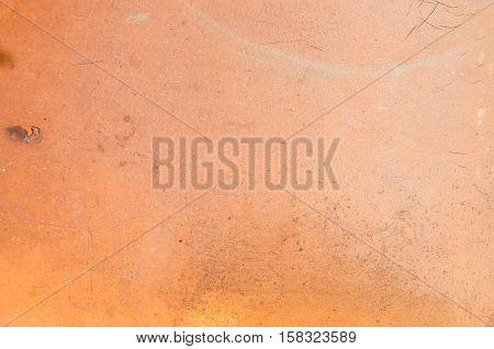 Close up dirty orange leatherette sofa texture