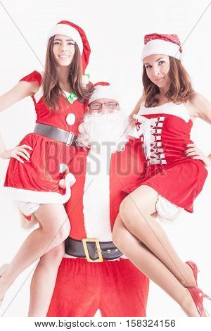 Your father is hero. Strong Santa holding a hot girls at the hands. Santa girlfriend. Christmas party 2016. Celebrating New Year 2017