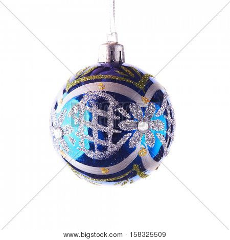 Glass blue toy with silver pattern for decoration of a Christmas and New Year fir tree on a white background.