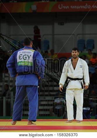 RIO DE JANEIRO, BRAZIL - AUGUST 12, 2016: Egyptian Judoka Islam El Shehaby (L) refuses to shake hands with Israeli Ori Sasson after losing men +100 kg match of the Rio 2016 Olympic Games