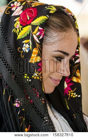 QUARTU S.E. ITALY - September 17 2016: Parade of Sardinian costumes and floats for the grape festival in honor of the celebration of St. Helena. - Sardinia - portrait of a beautiful woman in traditional Sardinian costume